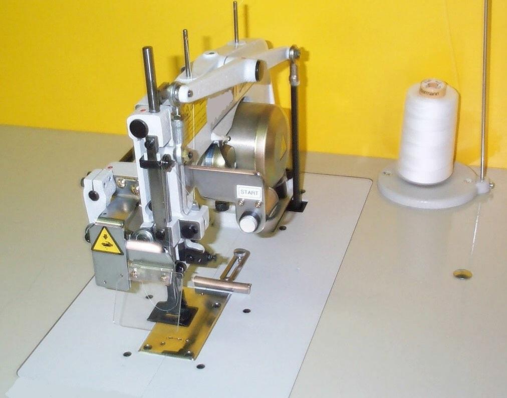 machine fixation d tiquette avec un seul point de couture smecri fabricant francais de. Black Bedroom Furniture Sets. Home Design Ideas